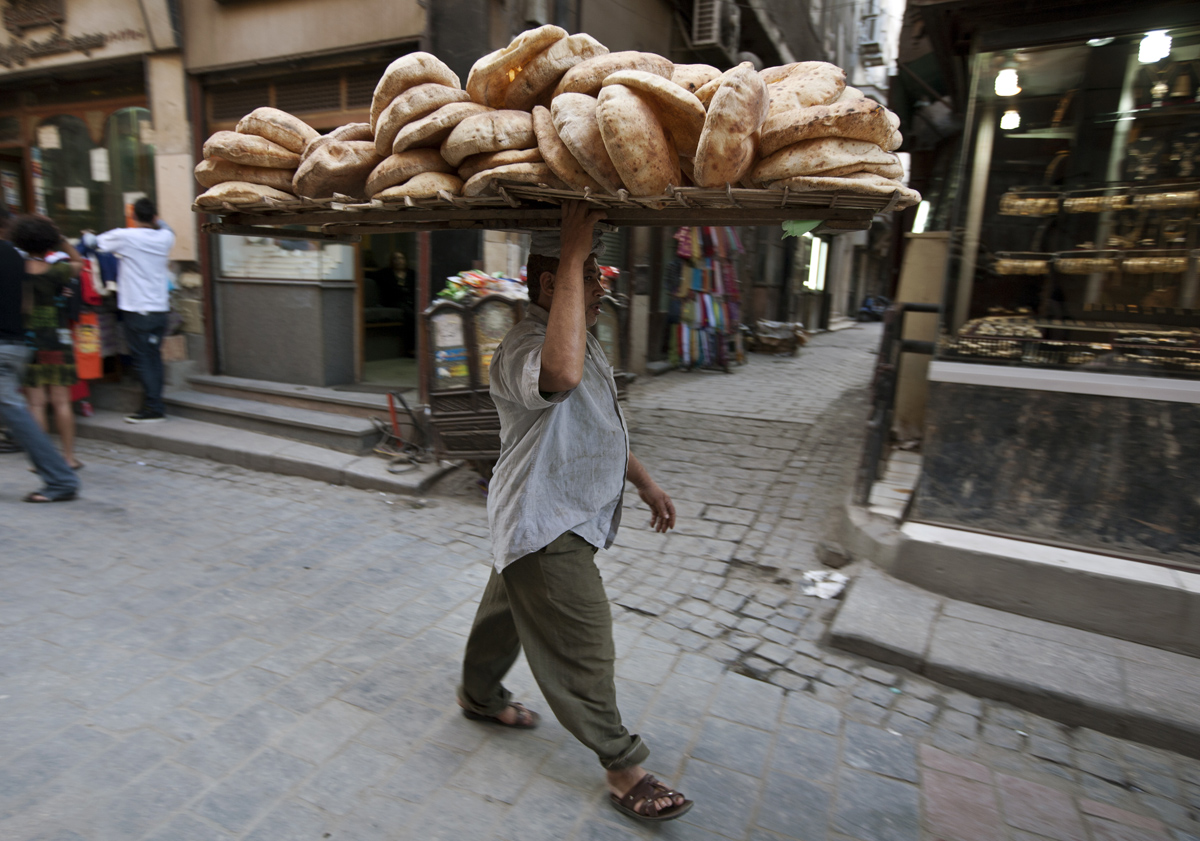 Guy Walking With Bread, Cairo, Egypt